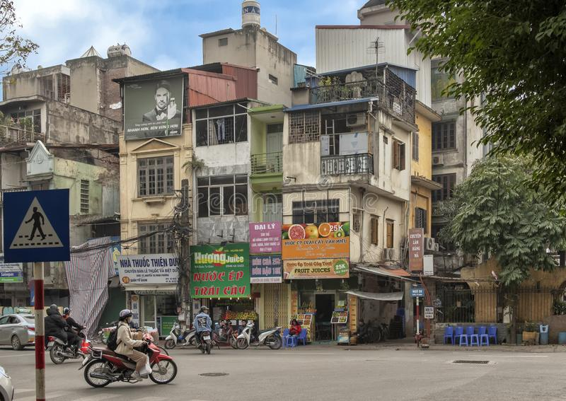 Multi-story buildings and motorbikes, Hanoi, capital of Vietnam royalty free stock photos