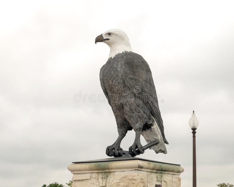 One of a pair of bald eagle sculptures at the entrance to the Veteran`s Memorial Park, Ennis, Texas. Pictured is one of a pair of bald eagle sculptures at the stock photos