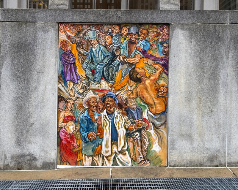 Unifying the Cultures of Neighborhood in Philadelphia, mural by Joseph and Gabriele Tiberino. Pictured is one of a series of five murals entitled `Unifying the stock images
