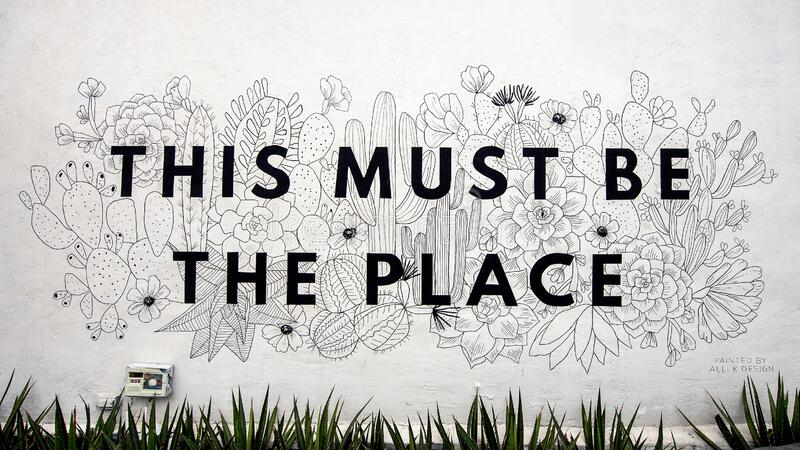 `This Must Be The Place`, an outside mural painted by Alli K Design in Dallas, Texas. Pictured is an outside mural titled `This Must Be The Place` by artist Alli stock image