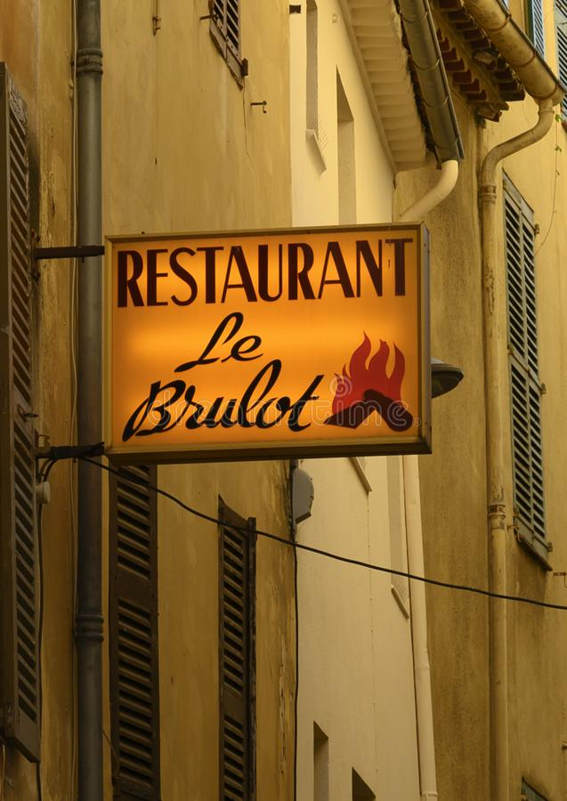 Outside sign for the historic Le Brulot Restaurant in town of Antibes on the French Riviera royalty free stock photo