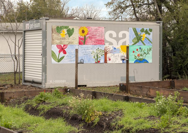 Small building and murals by teens at La Bajada Urban Youth Farm, Dallas, Texas. Pictured is part of La Bajada Urban Youth Farm, a non-profit with a two-fold royalty free stock photos