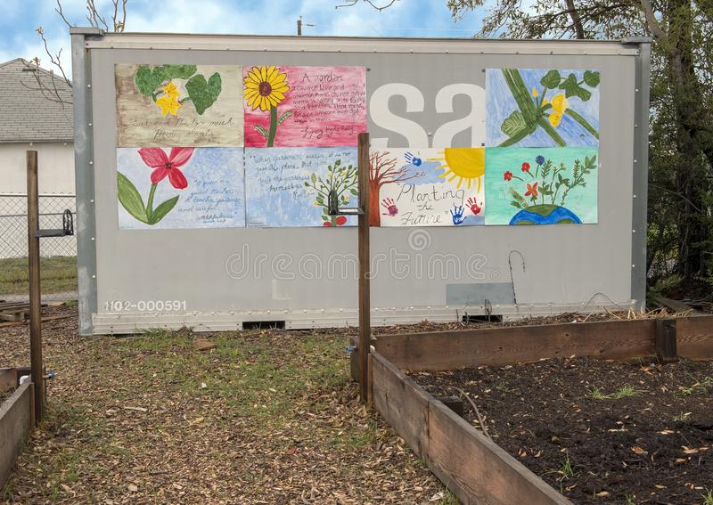 Small building and murals by teens at La Bajada Urban Youth Farm, Dallas, Texas. Pictured is part of La Bajada Urban Youth Farm, a non-profit with a two-fold stock images