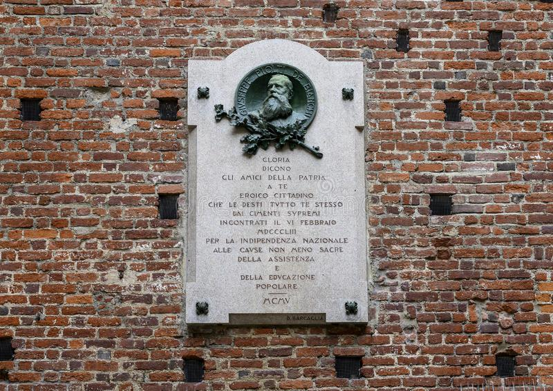Plaque to commemorate Giuseppe Piolti de Bianchi, Sforza Castle  in Milan, Italy royalty free stock image