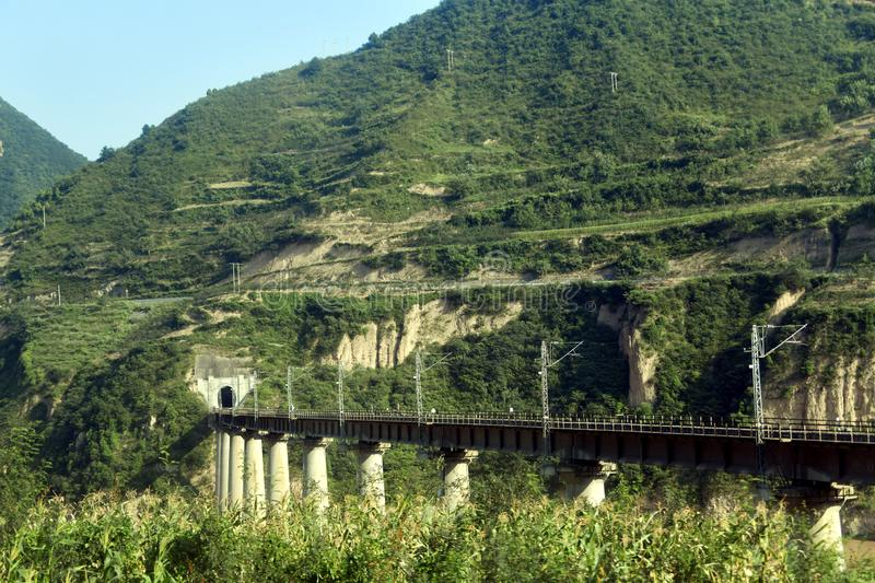 Qinling Mountains: scenery on the north south boundary of China. Pictured in Qinling Mountains, railways, highways, tunnels and bridges are built to ensure their stock photography