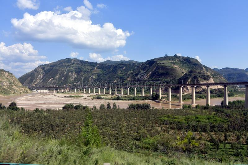Qinling Mountains: scenery on the north south boundary of China. Pictured in Qinling Mountains, railways, highways, tunnels and bridges are built to ensure their royalty free stock photography