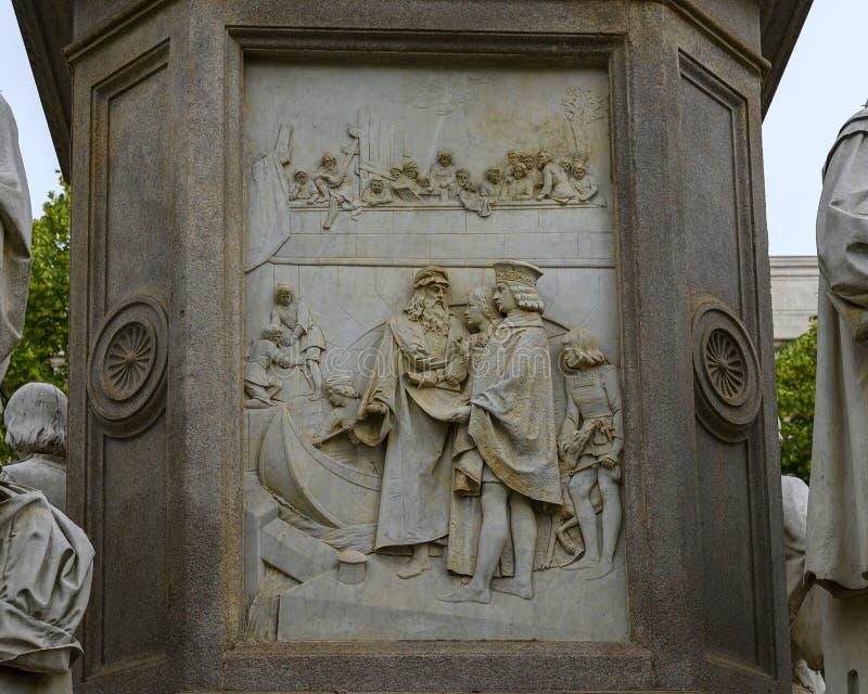 Engineering relief left side of the Monument to Leonardo Da Vinci in Piazza della Scala Square, Milan, Italy. Pictured is a relief representing Leonardo`s royalty free stock photo