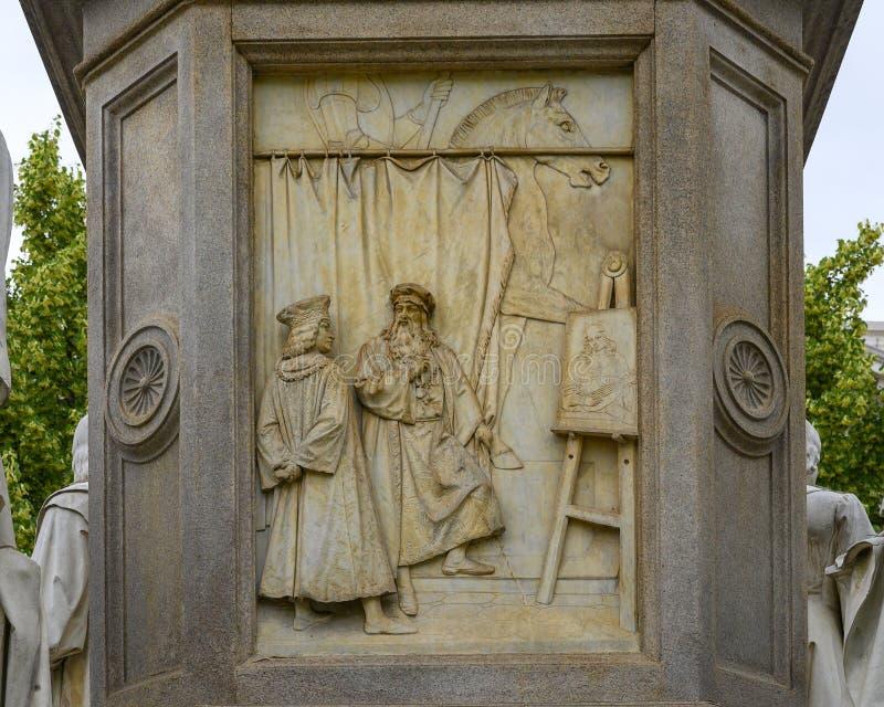 Sculpting relief front of the Monument to Leonardo Da Vinci in Piazza della Scala Square, Milan, Italy. Pictured is a relief representing Leonardo`s mastery of stock photos