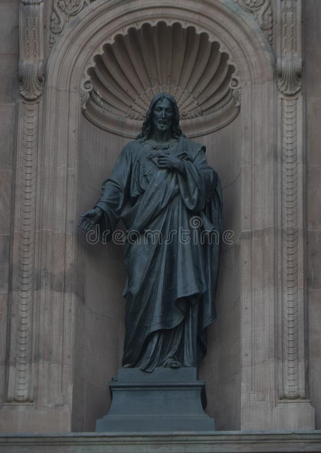 The `Sacred Heart` bronze statue of Jesus in a niche on the front of the Cathedral Basilica of Saints Peter and Paul, Philadelphia royalty free stock photo