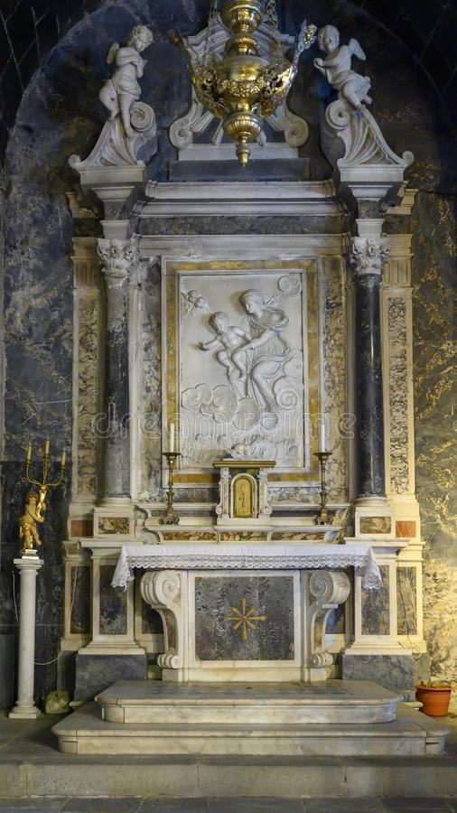 Side altar with Madonna and Child, Church of Santa Margherita d`Antiochia in Vernazza, Liguria, Italy stock photos