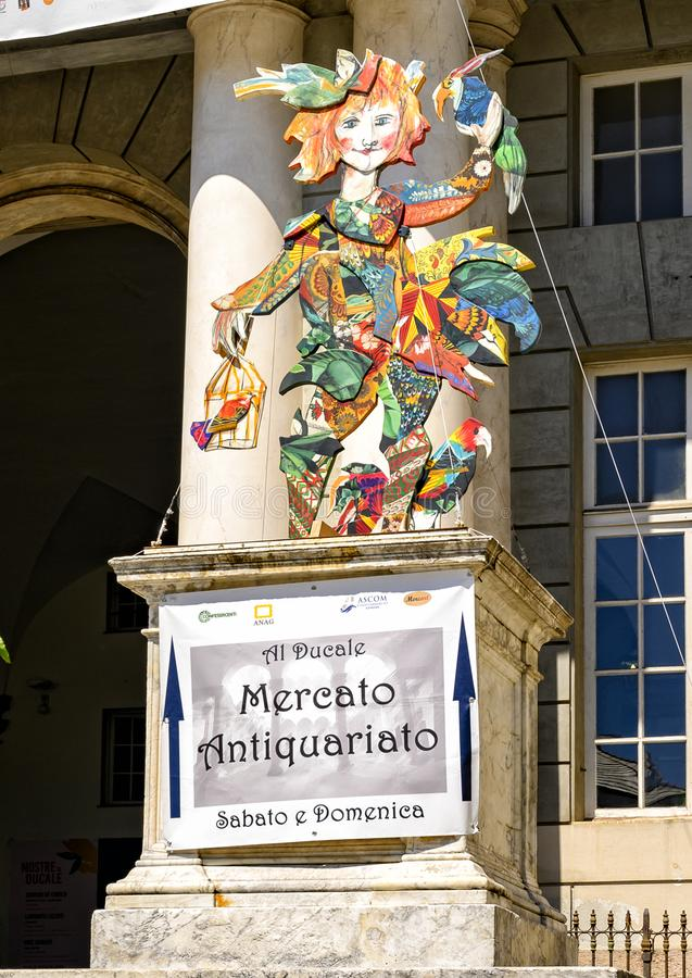 Sign promoting an Antique Market in front of the Doge`s Palace, a historical building in Genoa, northern Italy. Pictured is a sign promoting an Antique Market in royalty free stock photos