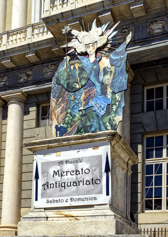 Sign promoting an Antique Market in front of the Doge`s Palace, a historical building in Genoa, northern Italy. Pictured is a sign promoting an Antique Market in stock photos