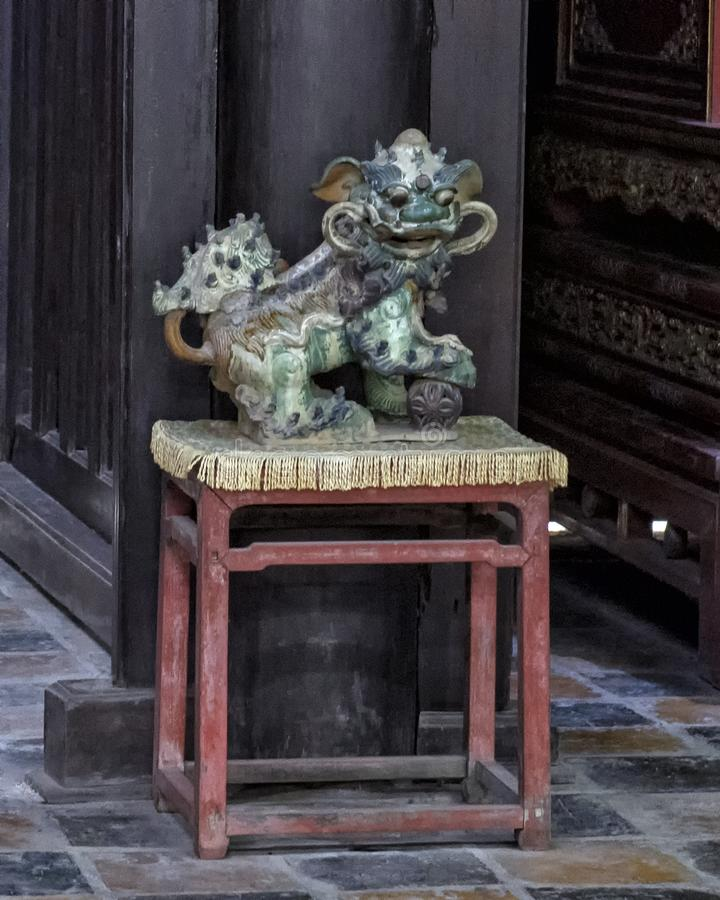 Statue of male Foo Dog inside the Hoa Kheim Palace, Tu Duc Royal Tomb, Hue, Vietnam royalty free stock photo