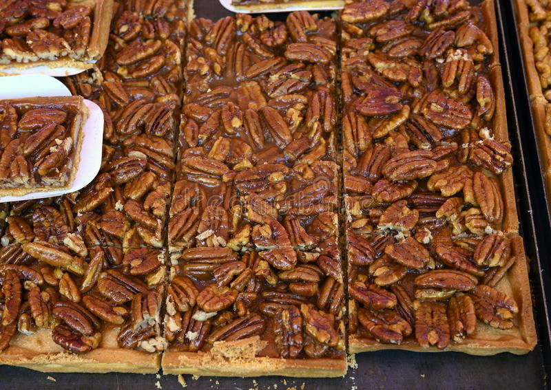 Fresh made pecan desert on sale in the Cours Saleya Market in the old town of Nice, France stock image