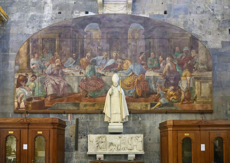 Statue of Pope John Paul II with painting of the Lord`s Supper, Genoa Cathedral stock photography