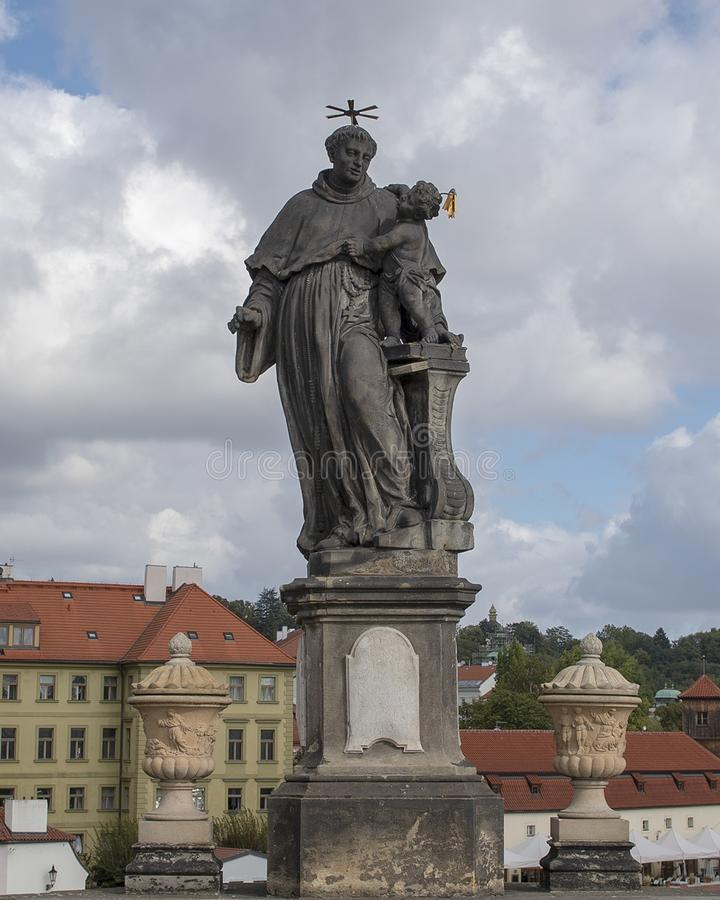 Statue of Saint Anthony of Padua, Charles Bridge, Prague, Czech Republic. Pictured is a Statue of St. Anthony of Padua, dressed in a regular vestment, standing royalty free stock photography