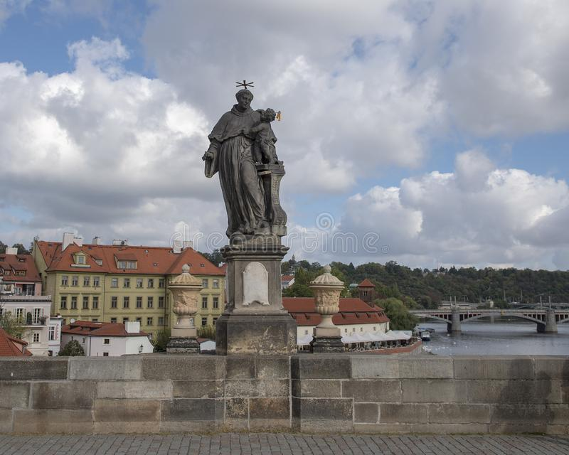 Statue of Saint Anthony of Padua, Charles Bridge, Prague, Czech Republic. Pictured is a Statue of St. Anthony of Padua, dressed in a regular vestment, standing stock photo