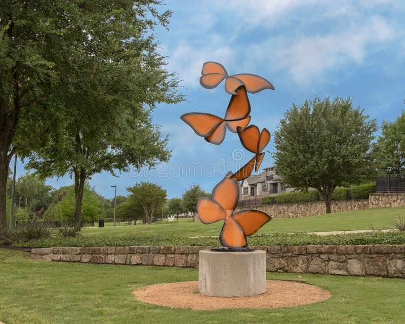 `Life Flutters By`, a steel sculpture by Laura Walters Abrams located in Watercrest Park, Dallas, Texas. Pictured is a steel alloy with powdered paint sculpture stock photos