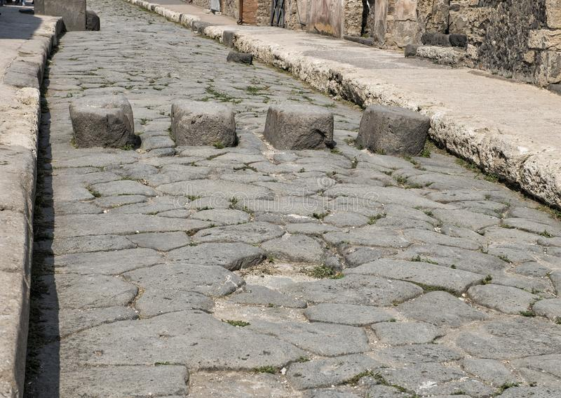 Streets with stepping stones, Scavi Di Pompei. Pictured are the stepping stones for crossing the street in the Scavi Di Pompei. The stepping stones kept your royalty free stock photos