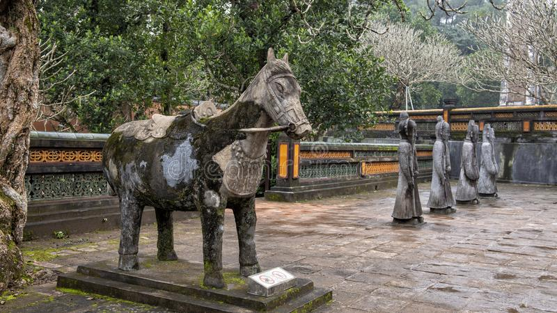 Horse and Stone mandarin sculptures in the forecort preceding the Stele Pavilion in Tu Duc Royal Tomb, Hue, Vietnam. Pictured are a stone horse and stone stock images