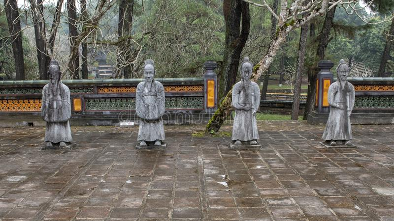 Stone mandarin sculptures in the forecort preceding the Stele Pavilion in Tu Duc Royal Tomb, Hue, Vietnam. Pictured are stone mandarin sculptures in the royalty free stock photos