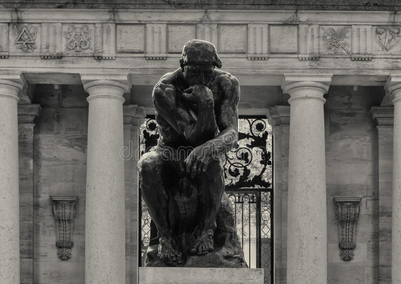 The Thinker by Aguste Rodin at the Rodin Museum entrance, Benjamin Franklin Parkway, Philadelphia, Pennsylvania. Pictured is `The Thinker` by Aguste Rodin at the royalty free stock photography