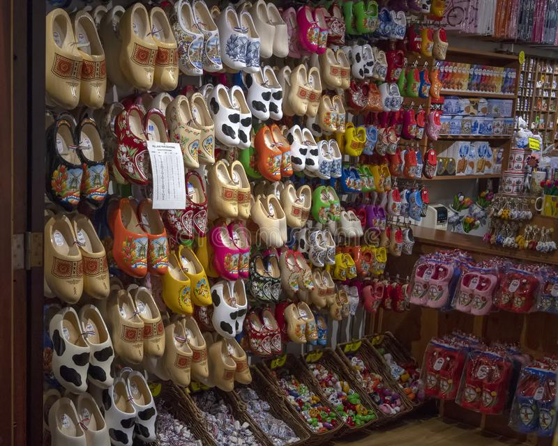 Traditional Dutch clogs for sale in Amsterdam, Netherlands. Pictured is a wall of traditional Dutch clogs for sale in Amsterdam, Netherlands. Clogs are a type of stock images
