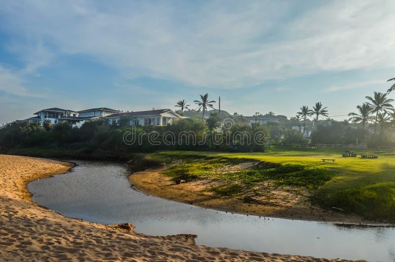 Pictureque Salt rock main beach and a river lagoon στην ακτή Dolphin Durban Ballito Νότια Αφρική στοκ φωτογραφία