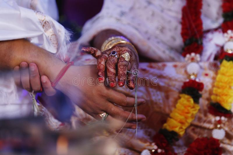 Pictures of bride and groom at their wedding. Performing religion rituals . stock photography