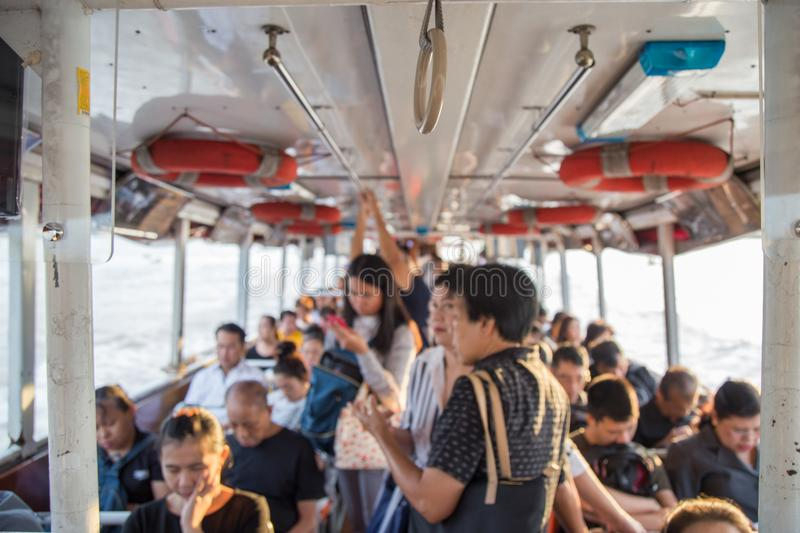 Pictures of people going to work place by the Chao Phraya Express Boat in the morning stock images