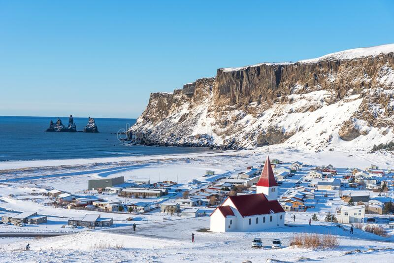 Picturesque aerial view of Vik I Myrdal church at the top of the hill in Iceland in winter. Panoramic beautiful view of village Vik and Myrdal church in winter royalty free stock photos