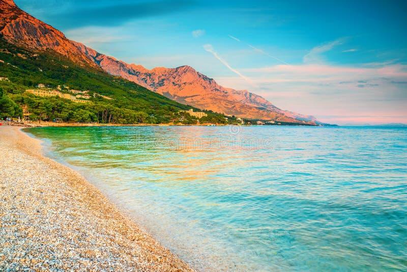 Picturesque bay with gravel beach, Brela, Makarska riviera, Dalmatia, Croatia. Wonderful summer vacation and beach destination. Popular gravel beach with high stock image