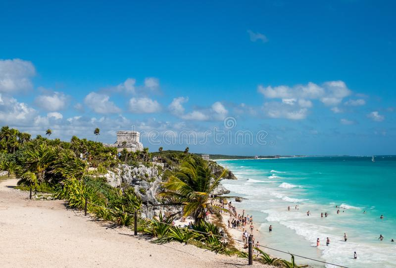 Beautiful Caribbean coastline and ancient Mayan ruins of Tulum overlooking beach in Mexico royalty free stock images