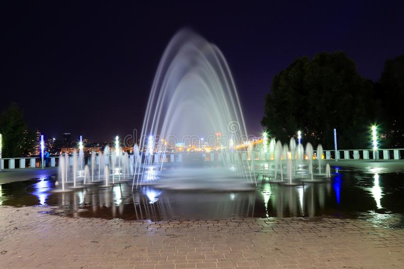 Picturesque, beautiful fountain against the background of the night sky in city. Evening view of Dnepropetrovsk, Ukraine, Dnipro. Picturesque, beautiful fountain royalty free stock image
