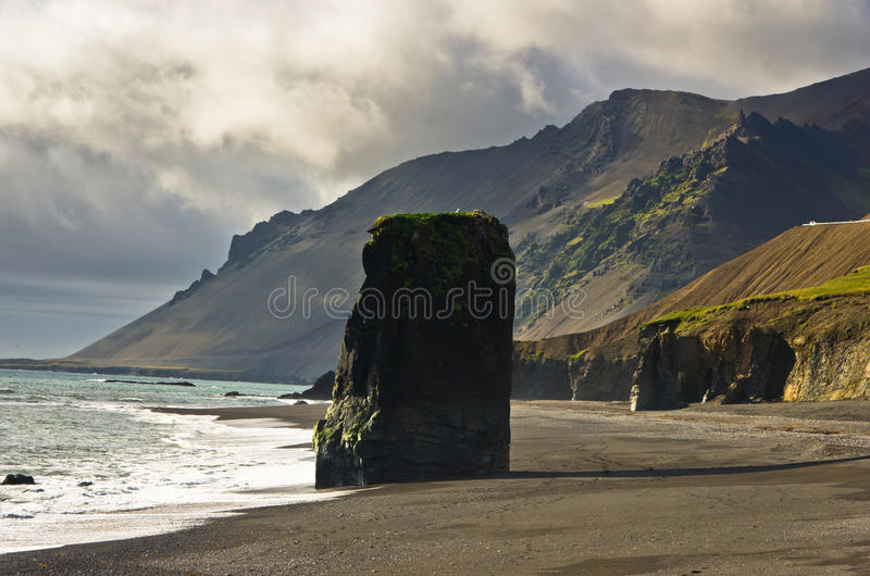 Picturesque black sand volcanic beach at summer, south Iceland royalty free stock photography