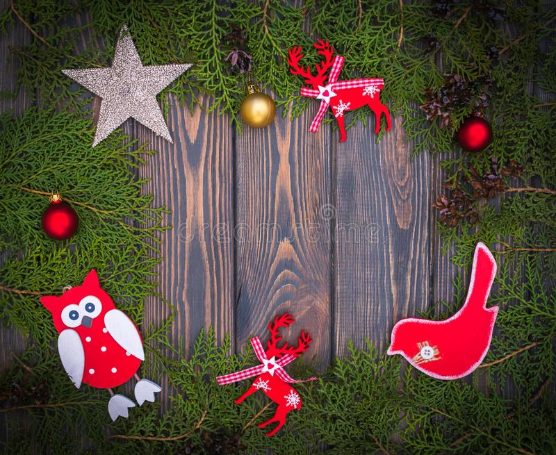 Christmas tree toys handmade and green spruce branches royalty free stock images