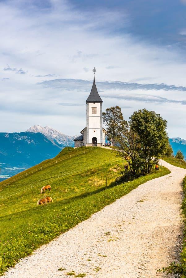 Picturesque  Church Of St Primoz.in Jamnik,Kamnik, Slovenia at Autumn. Alpine, alps, attraction, beautiful, catholic, countryside, europe, farming, farmland stock photos