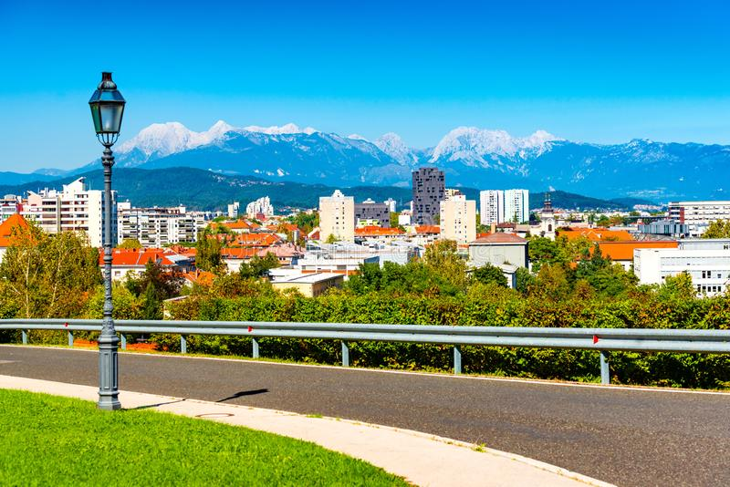 Picturesque cityscape of a European modern city with a beautiful mountain range in the background.  stock image
