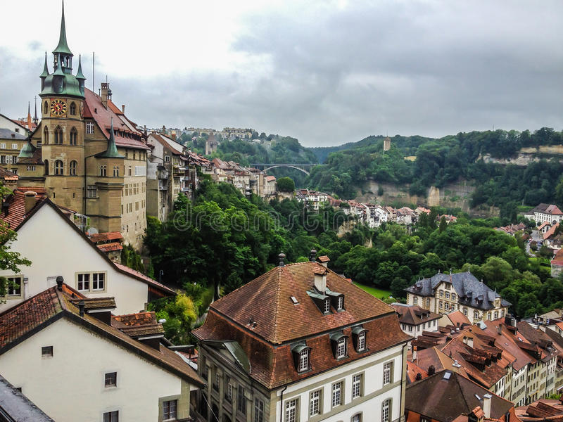 Picturesque cityscape of medieval town Fribourg with its gothic cathedral, old town and ancient fortification, Switzerland, Europe royalty free stock images