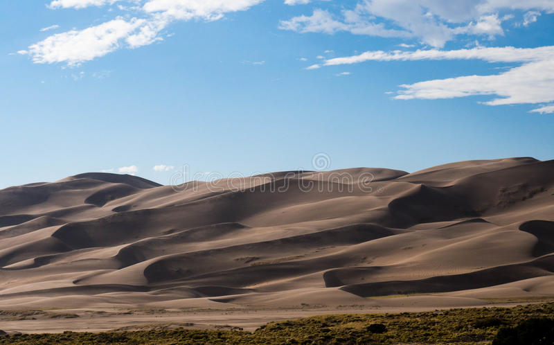 Picturesque clouds over Great Sand Dunes National Park stock photos