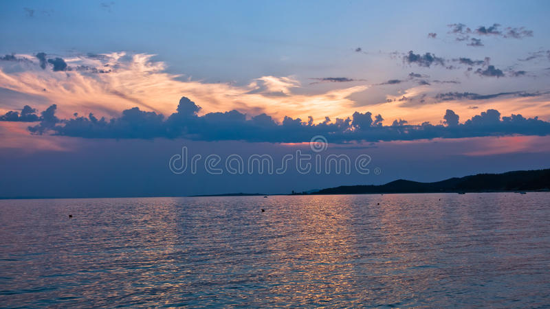 Picturesque cloudscape at sunset, west coast of peninsula Sithonia. Greece stock image