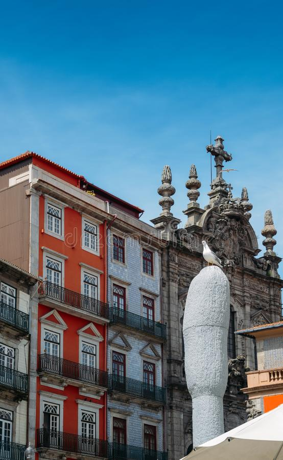 Picturesque colorful houses covered in azulejo tiles in Porto with a baroque style church royalty free stock image
