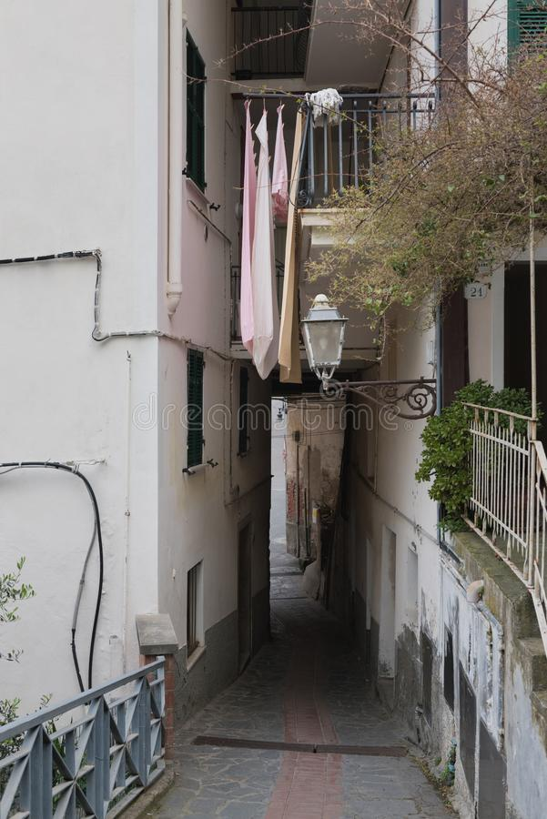 Picturesque colorful narrow curve small street with streetlight in Manarola fishing village in Five lands, Italy royalty free stock images