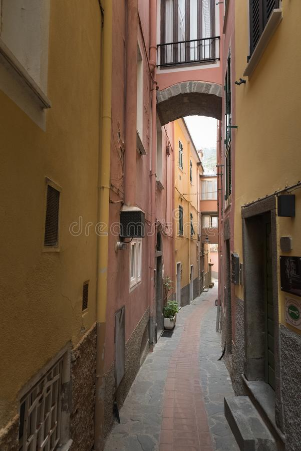 Picturesque colorful narrow curve small street with streetlight in Manarola, Italy royalty free stock photos