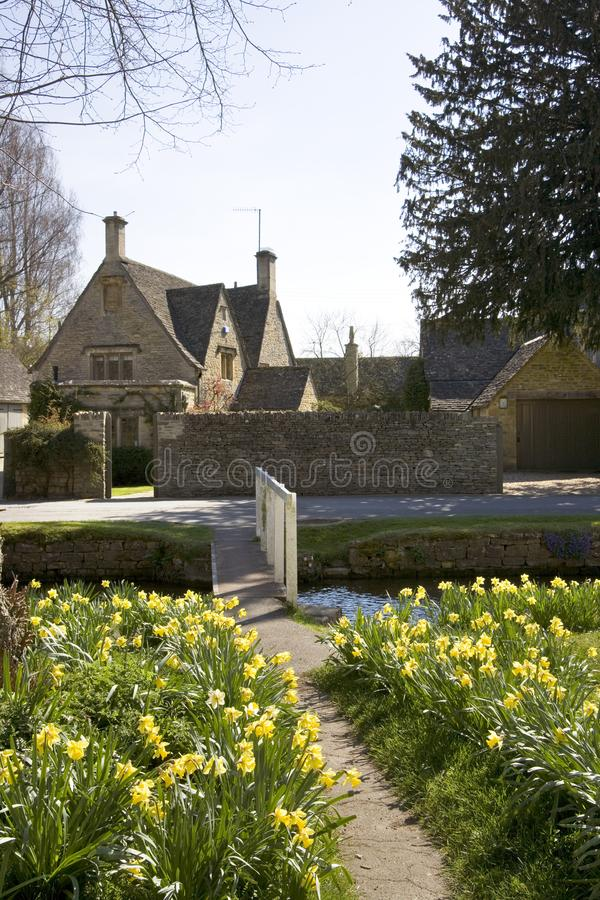 Picturesque Cotswolds - Lower Slaughter. Cotswold cottage and the River Eye in spring sunshine, Lower Slaughter, Gloucestershire, UK royalty free stock photography