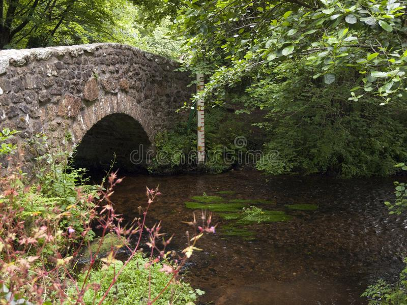 Picturesque Dartmoor. Typical old stone bridge over the River Bovey at North Bovey on the edge of Dartmoor National Park, Devon, UK royalty free stock images