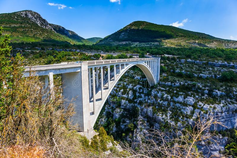 The picturesque deep Verdon Gorge. Grandiose bridge over the mountain canyon Verdon, Southern France, Provence. The picturesque deep Verdon Gorge in the stock photo