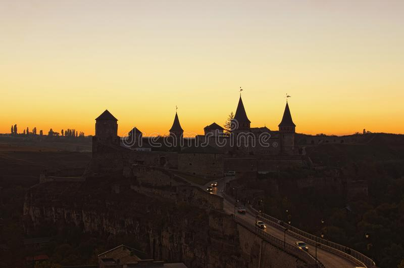 Picturesque evening view of Kamianets-Podilskyi castle. Autumn sunset landscape. Famous touristic place and travel destination royalty free stock photos