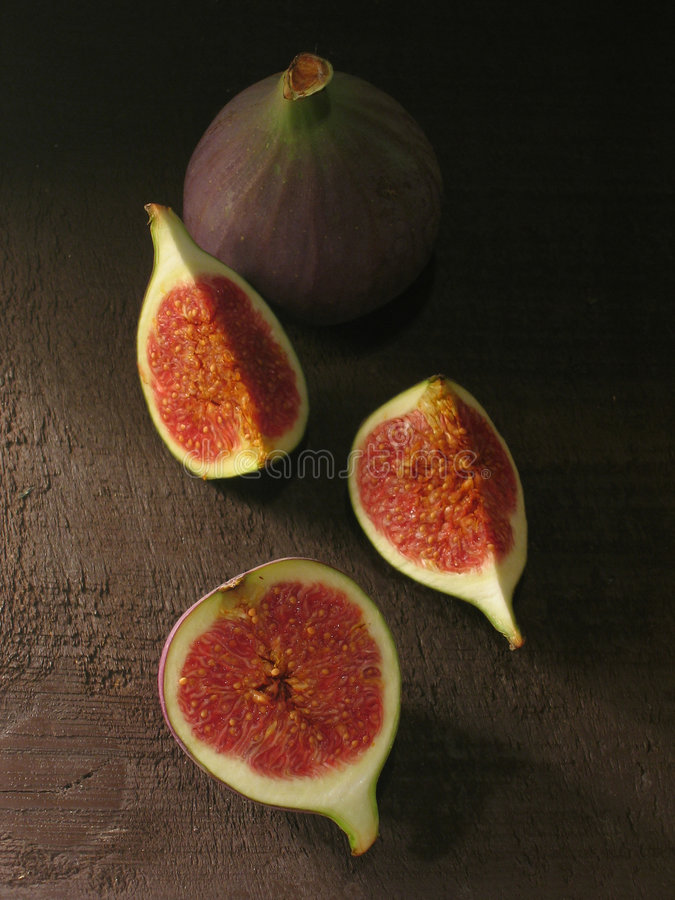 Picturesque figs. On wooden background royalty free stock photos