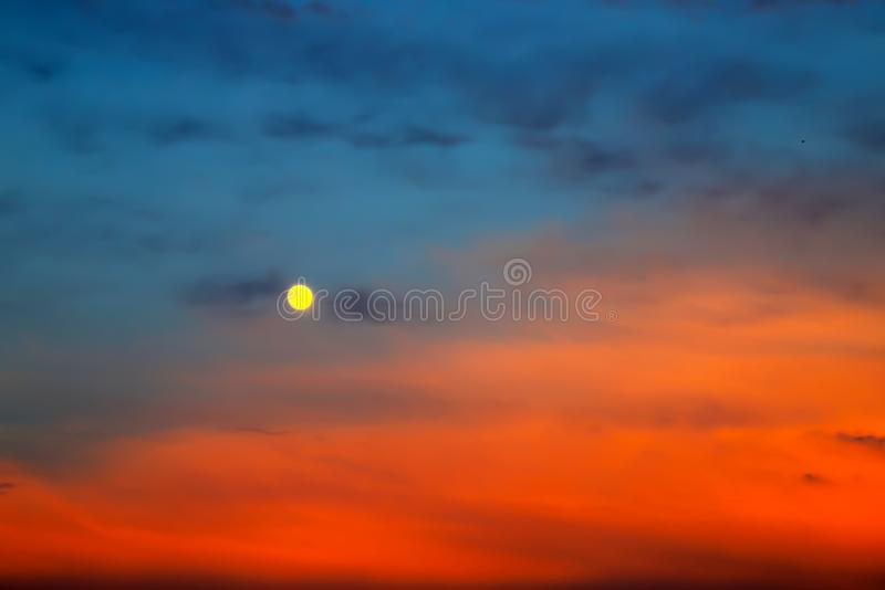 Picturesque Full moon on a background of beautiful blue and red clouds. Clouds at sunset, sunrise during the full moon. Cloud royalty free stock photography